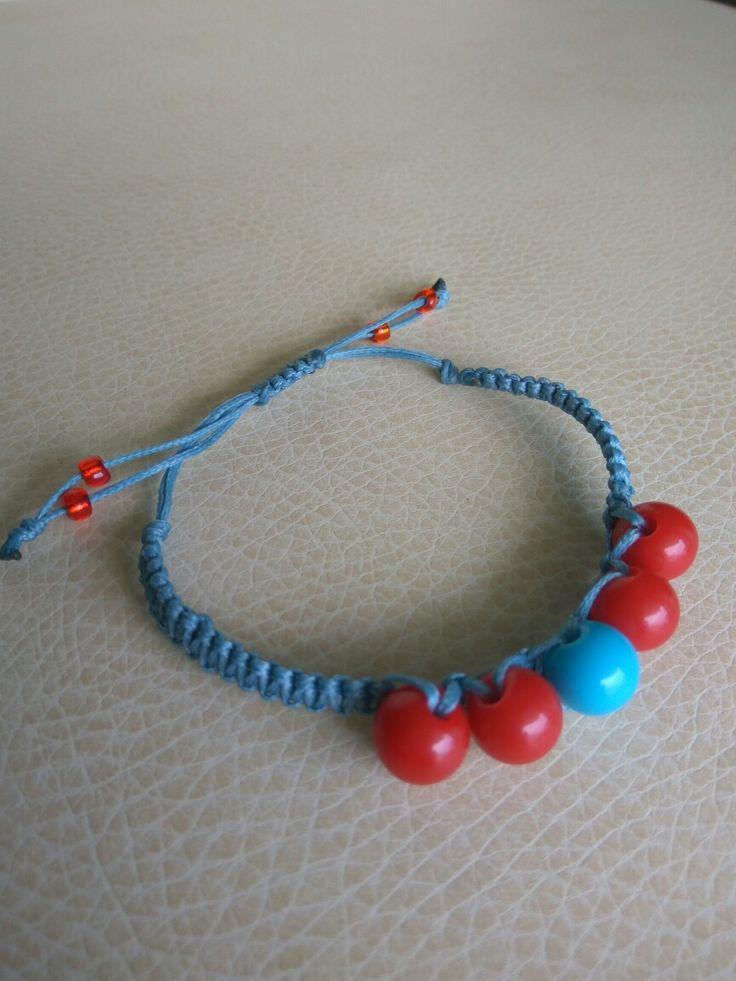 Red and blue beads in a beautiful blue macrame bracelet