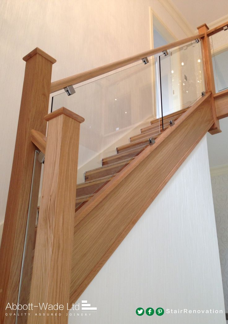 A glass balustrade with square brackets.