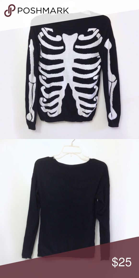 Skeleton knit sweater - Halloween costume Crew neck and long sleeves. Black skeleton sweater with rib cage and arm bones down sleeves. Worn once and in excellent condition. Size Medium Halloween Sweaters Crew & Scoop Necks
