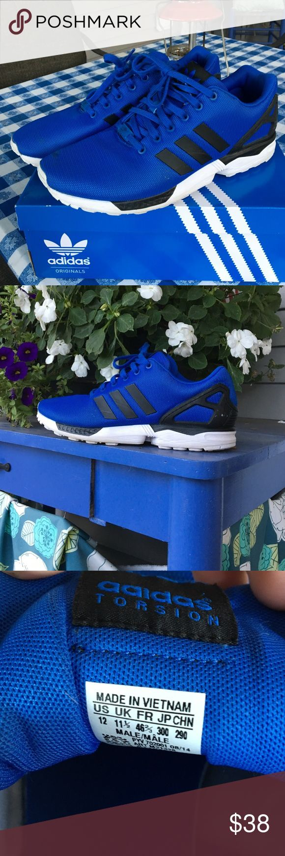 Adidas ZX Flux (blue) Comfortable blue mesh upper, stylish branding on medial and lateral sides as well as the tongue, and a torsion bar and plastic heel cage make this shoe the ultimate day to day wear. Minor scratches on stripes and cage, some discoloring on toe box can be removed with cleaner. Size 12 men's US. Adidas Shoes Sneakers
