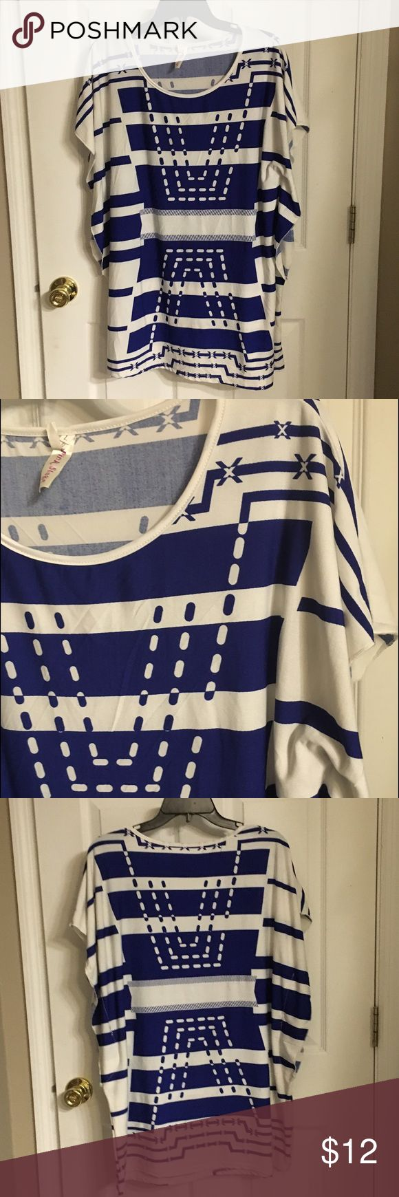 "Blue & White Batwing Top Cute top with batwing sleeve and longer length. Made of soft stretchy material. I call this my ""R2D2 shirt."" Received lots of complements in this one! Gently used but still in great condition. Smoke free home. Tops"