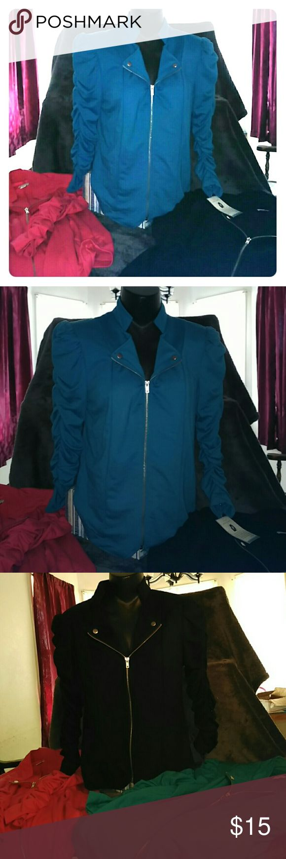 Set of 3 large zippered tops These look great with skinny jeans and boots! I've worn the black and red one a couple of times. The teal one still has tags. Scrunchy sleeves. Light shoulder pads. Zippered front. Silver detail. Tops Blouses