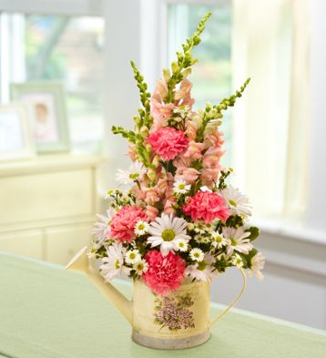 Learn how to create a unique DIY Mother's Day floral arrangement using a watering can as your vase from flower expert Jerry Rosalia! Only on the 1800Flowers blog, Petal Talk! #diymothersdaycrafts #mothersdayflowers