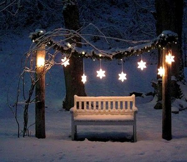 Hang some Christmas lanterns on your garden, swing or yard.