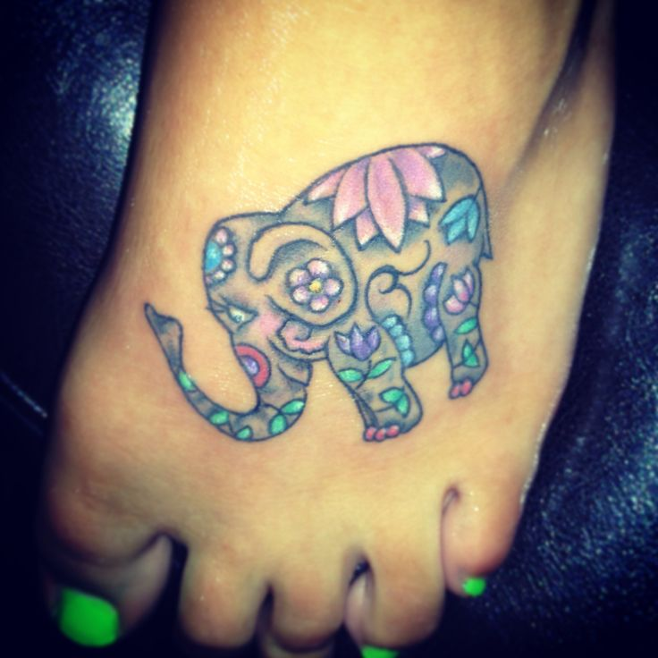 lotus watercolor elephant tattoo on foot