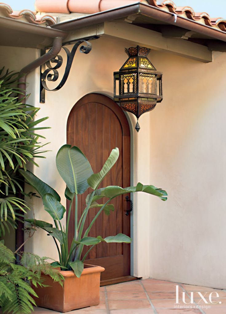 Brown mediterranean style arched front door luxe for Mediterranean style entry doors