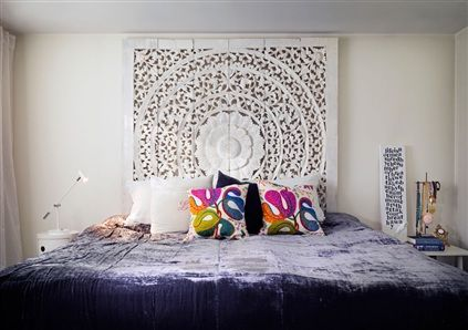 whitewashed temple painting from Tibet as a headboard (from Indori) + bedspread from H & M Home