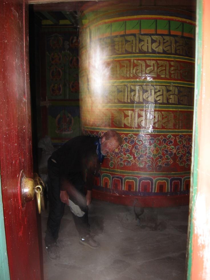 The author spins giant Tibetan prayer wheel, Pangboche, Nepal.