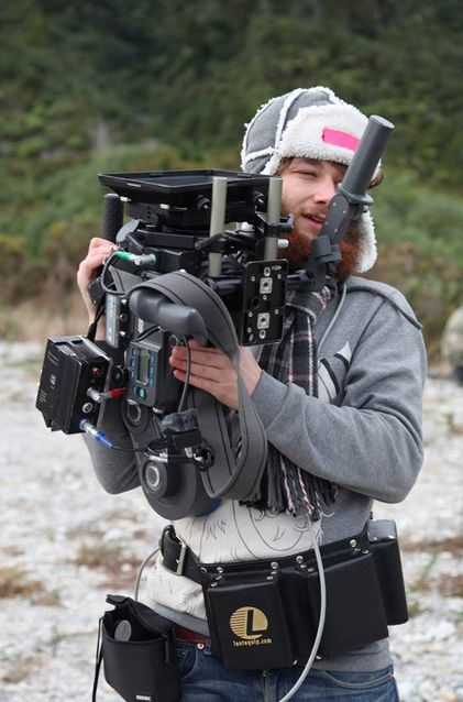 Alan Waddingham (director of photography) on location in New Zealand's South Island, with an Arriflex 235 and a trusty battery belt - ready to roll.