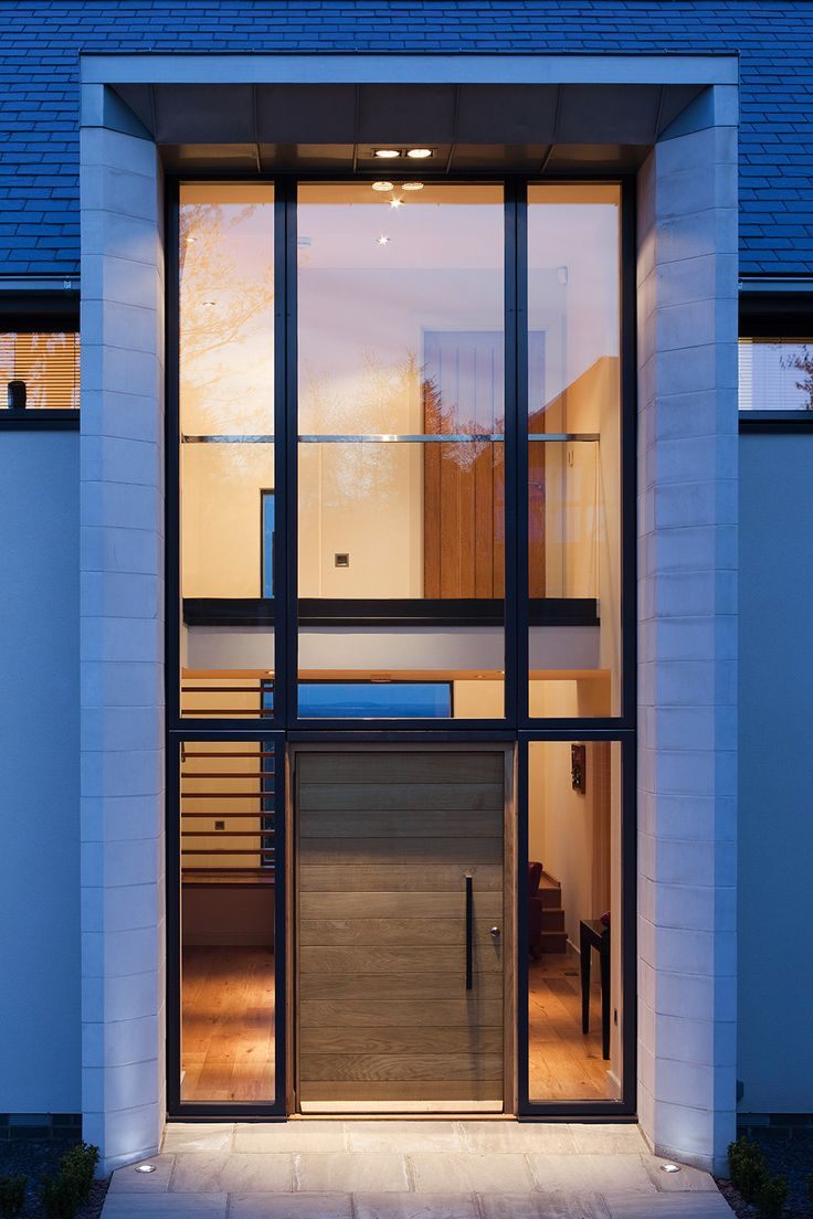 Style of entrance with glazing and front door , but with vertical oak panels