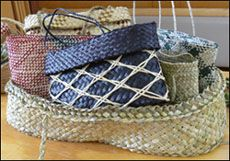 NZ flax weaving blog - baby basket (wahakura) filled with kete