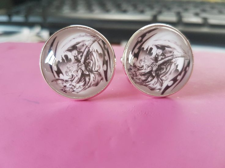 these custom made cufflinks were designed to show this grooms favourite tattoo