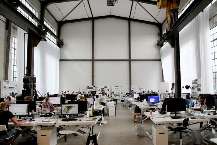 designboom dropped by the internationally renowned firm\'s new studio in copenhagen, taking a tour of the industrial space that houses a large open workspace, several glass enclosed meeting rooms for more private discussions, a canteen, a vast library of books and magazines, and an extensive display of models which represent the prolific nature of BIG\'s practice.