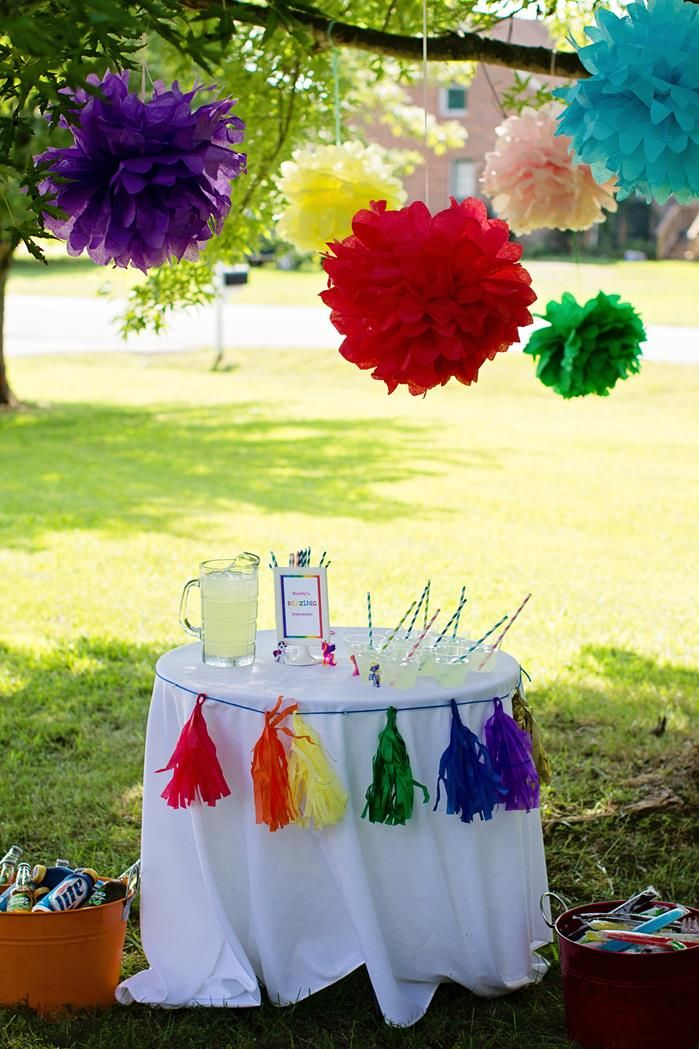 """This """"My Little Pony Rainbow Party"""" is loaded with cute ideas.  One of them is this colorful drink station.  When you separate spaces for food, drink, play and more, it helps keep things tidy, and, makes the event feel bigger and grander.  This has great Pony Party Pizazz!"""