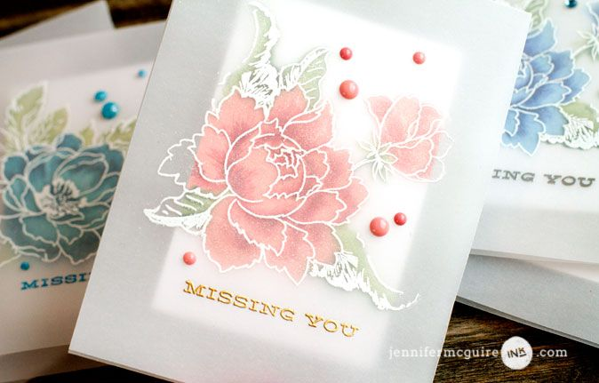 Vellum Overlay Cards Video by Jennifer McGuire Ink. I created my cards with my favorite heavyweight vellum and adhered the mini stamped card inside. After applying anti-static tool to the front, I heat embossed the outline image of the flower and leaves in white… directly on top of the images underneath. When heat embossing on vellum, I let the heat gun get very hot before bringing it to the vellum. This prevents warping.