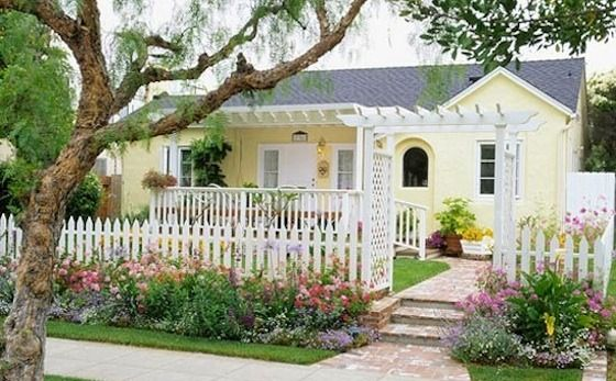 Landscaping Made Easy  Beautify your yard with our five simple landscaping ideas that add distinctive structure, easy-growing color, and notable curb appeal.: Picket Fences, Idea, Outdoor, Front Yards, Curb Appeal, Cottages, Yellow Cottage, Yellow House