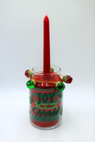 Fill a mason jar with colored sand to make a pretty candle holder for Christmas!