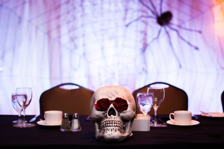 We are so excited to be sharing a Halloween inspired wedding today. This couple seriously looks like so much fun.  This wedding was documented a bit different than we are typically used to seeing. The bride mostly wanted party pictures and did not want a lot of details. So, there are not many detail shots but there are tons of fun wedding party pictures. Lindsay Ross Photography did an amazing job capturing the couple's beautiful ceremony and then the awesome rockin' Halloween party.