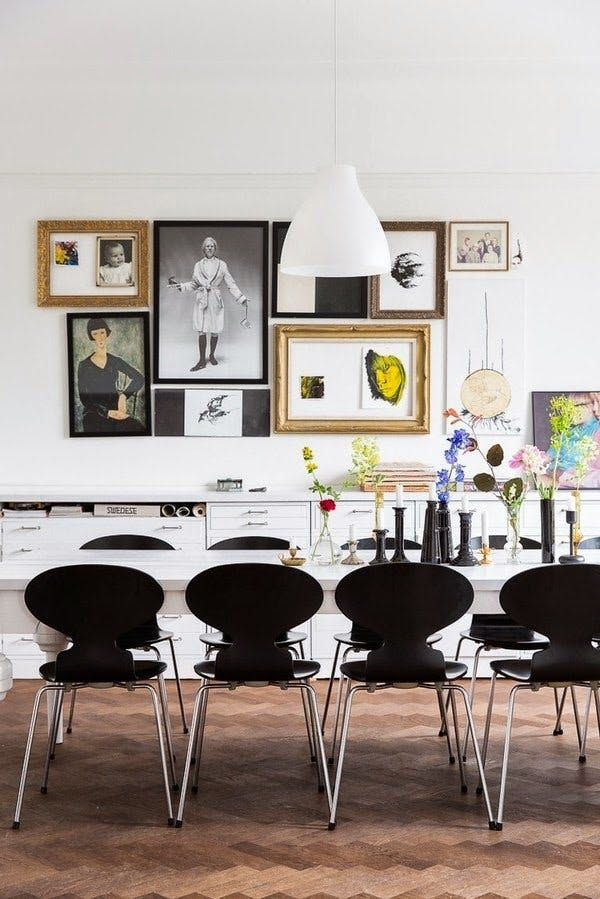 To make a gallery wall look more cohesive, group pieces closely together, and keep them within a single color family. Spotted on My Scandinavian Home.