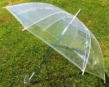 "Wholesale 46"" Auto Open Clear Umbrella. With a clear and plastic construction, this clear transparent umbrella offers protection from the weather. An automatic opening and stylish clear handle with silver highlights finish this umbrella. http://www.wholesalemart.com/Wholesale-Umbrellas-s/313.htm"
