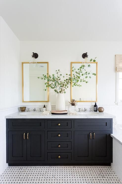 Rectangular Brass Mirrors Lit By Oil Rubbed Bronze And Clear Glass Sconces Fixed Over A White Bathroom Paint White Bathroom Inspiration Black Cabinets Bathroom