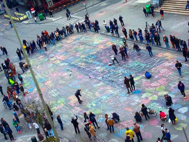 People in Brussels are coming out to write messages of love in the streets