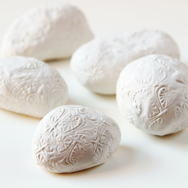 Make these Diy Embossed Clay Stone Paperweights using air dry clay