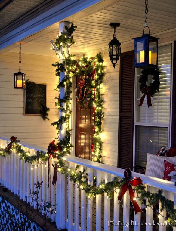 hanging candle lanterns – LOVE * her porch is similar to ours, just reversed. I wonder if I can find the automatic LED candles like she has!*