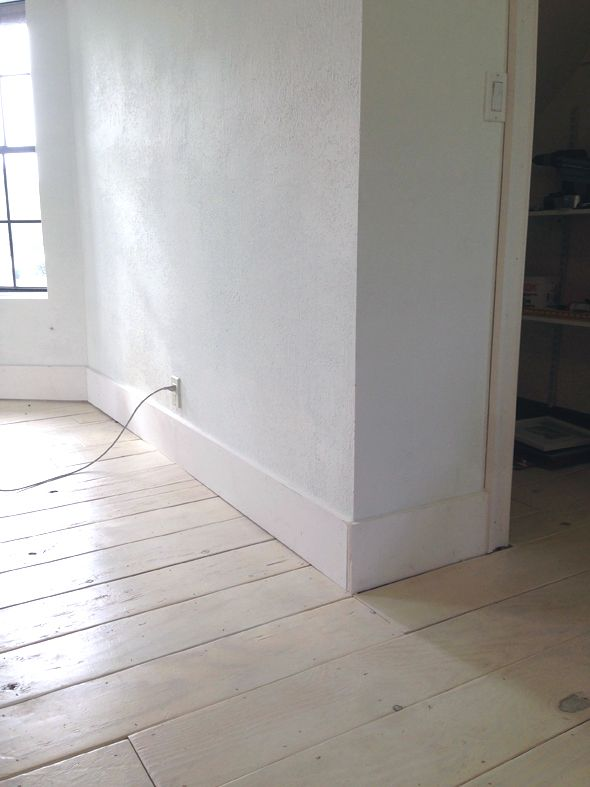 Use 8 Inch Primed Pine Boards As Simple Tall Baseboards