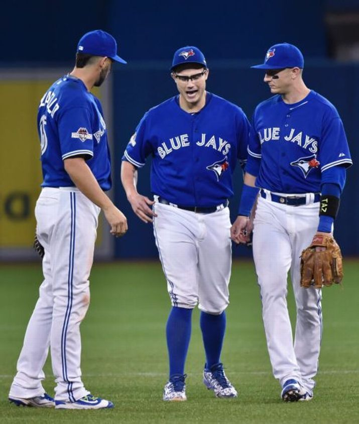 Chris Colabello and Troy Tulowitzki, TOR, stand with injured Brett Cecil//Game 2 ALDS v TEX, Oct 2015