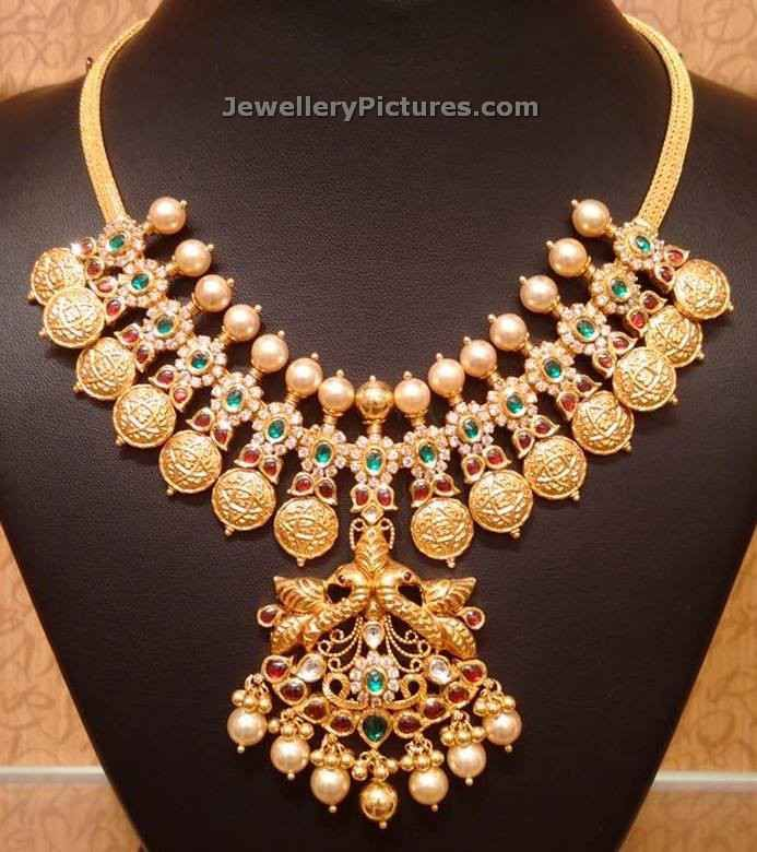 Adorable South Indian Jewellery in 22 carat goldshort kasu mala designs is decorated with kundans and south sea pearls.Peacock pendant is attached to the kasula chain. For details on weight and price contactNAJ jewellery. Address : 957, Jewel Junction, Achari Street, Nellore whatsApp : 9032041323 email : mynaj@najindia.com Related PostsLakshmi Kasulaperu DesignsKasulaperu Designs With WeightLatest …