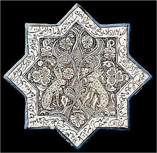 A lustre-decorated pottery star tile, Kashan, Central Persia, circa 1266-1267 A.D. of eight pointed stellar form, the decoration heightened in cobalt-blue and turquoise, the design of a central spray of split-palmettes flanked on each side by an hare, the dense ground of floral and foliate motifs, a border of cursive calligraphy. 21 cm.