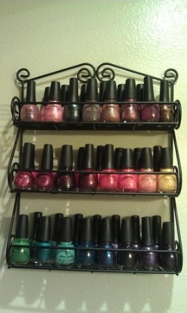Spectrum Wall-Mountable Black Scroll Spice Rack: Amazon.com: Kitchen & Dining....Spice rack to display nail polishes. great idea!