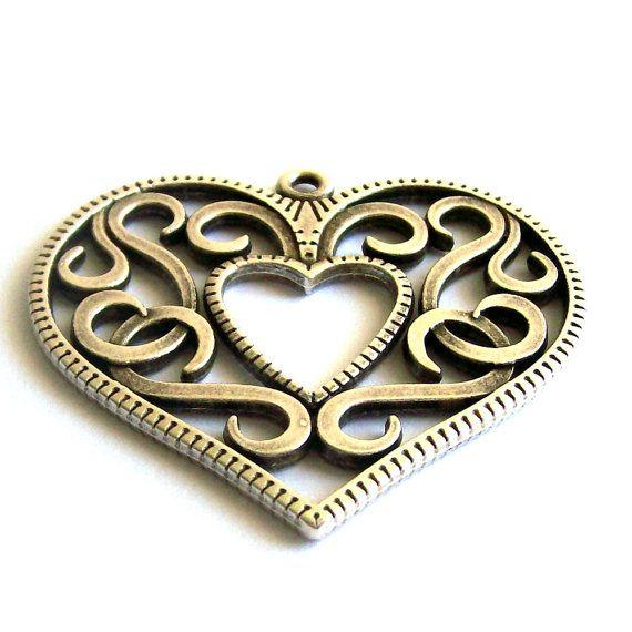 Filigree metal heart pendant - antique silver
