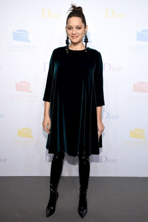 16 November Marion Cotillard wore a velvet smock dress with over-the-knee leather boots for a Dior event in New York.
