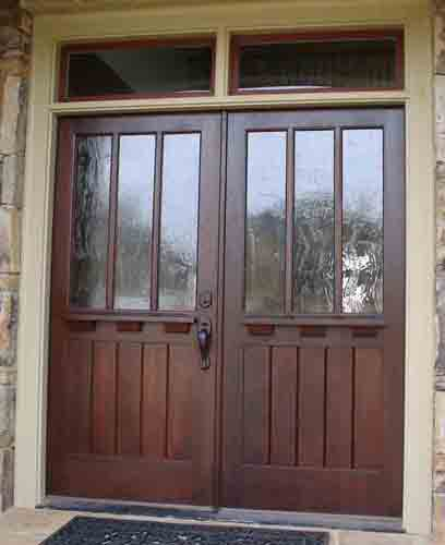 Custom craftsman style double entry door with transom.