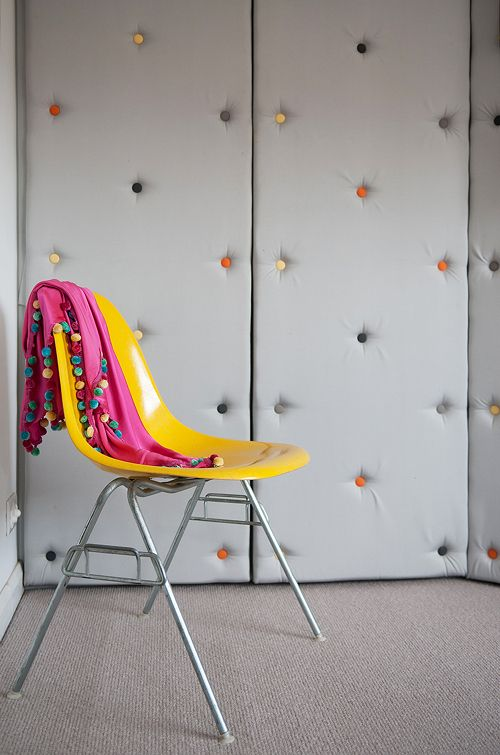 Button back upholstered wardrobe doors with coloured buttons. Designed by Edwina and Marc Boase