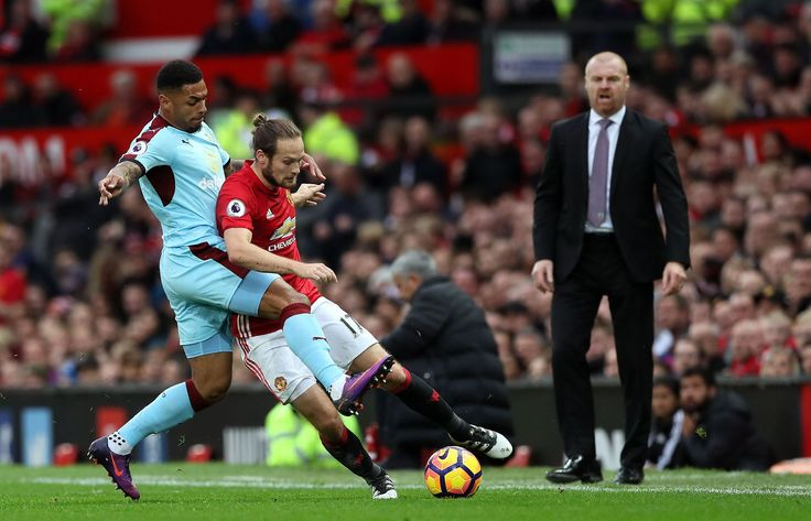 Burnley's Andre Gray and Manchester United's Daley Blind battle for the ball