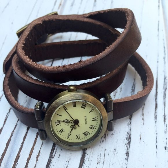 Vintage leather wrap watch Stylish Quartz watch with a vintage feel. Deep brown leather strap that wraps around the wrist approximately 3 times. Jewelry