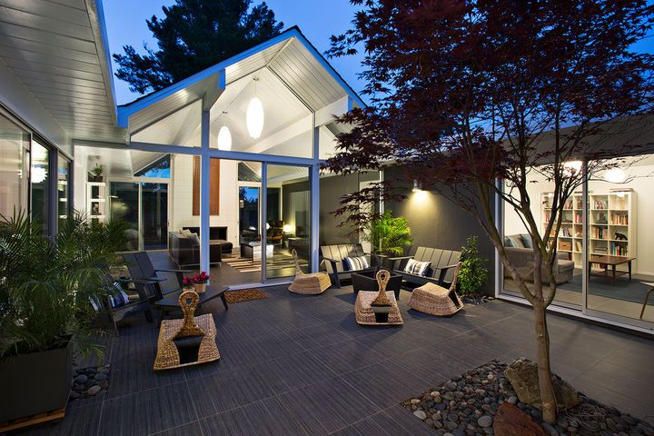 A remodeled Eichler in Burlingame, California, features a large glass wall that opens ontothe outdoor courtyard.  Courtesy of Mariko Reed.  This originally appeared in Eichler Remodel in Burlingame, California.