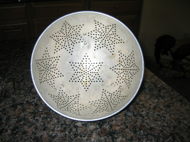 Mom's colander, look at it on the inside.  1950s