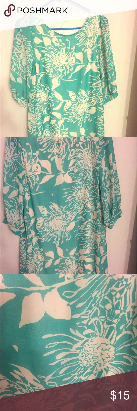 Mint green shirt dress with floral pattern. Comfortable and flattering shirt dress with fun floral pattern in mint green. Looks Great with boots or sandals. Excellent condition. Dresses Mini