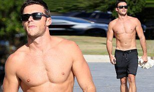 He is the genetically-blessed son of acting legend Clint Eastwood and on Thursday, Scott Eastwood had heads turning as he strut around shirtless along Sydney's Bondi Beach.