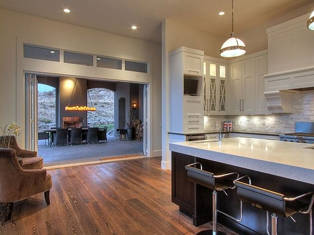 Beautiful Kitchen With A Small Seating Area That Opens Up To The Outdoor And Entertainment