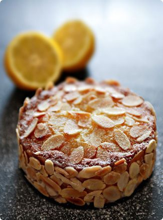 "lemon almond cake recipe - ""... one of the most delicious cakes I've ever eaten, sporting a thick layer of dense, buttery sponge, fragrant with ground almonds and almond extract and cradling a smear of bracingly tart lemon curd... the scattering of crunchy almond slivers providing just the perfect amount of textural contrast to the creamy topping and tight crumb."""