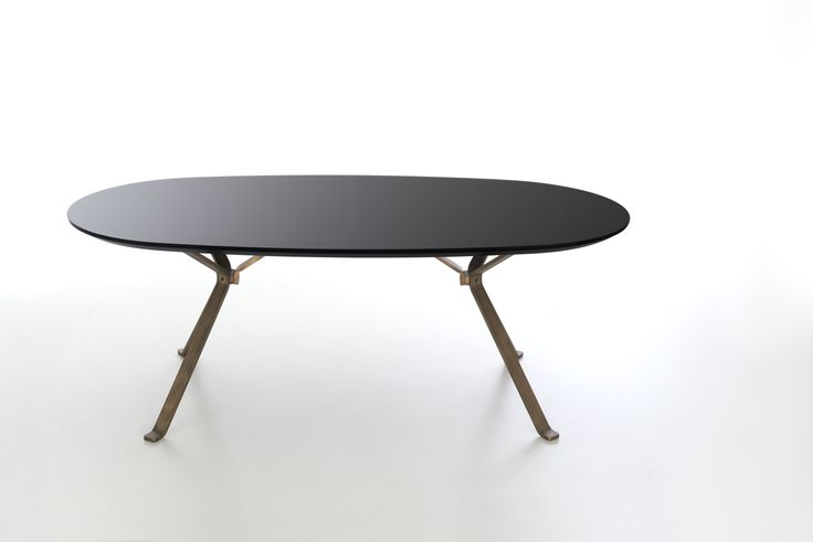 Revo oval table coll Reflections with black tempered glass top and vintage bronze legs. Product design by CMR.Color design and finishes by Raffaella Mangiarotti #focusoncolor #living #shining