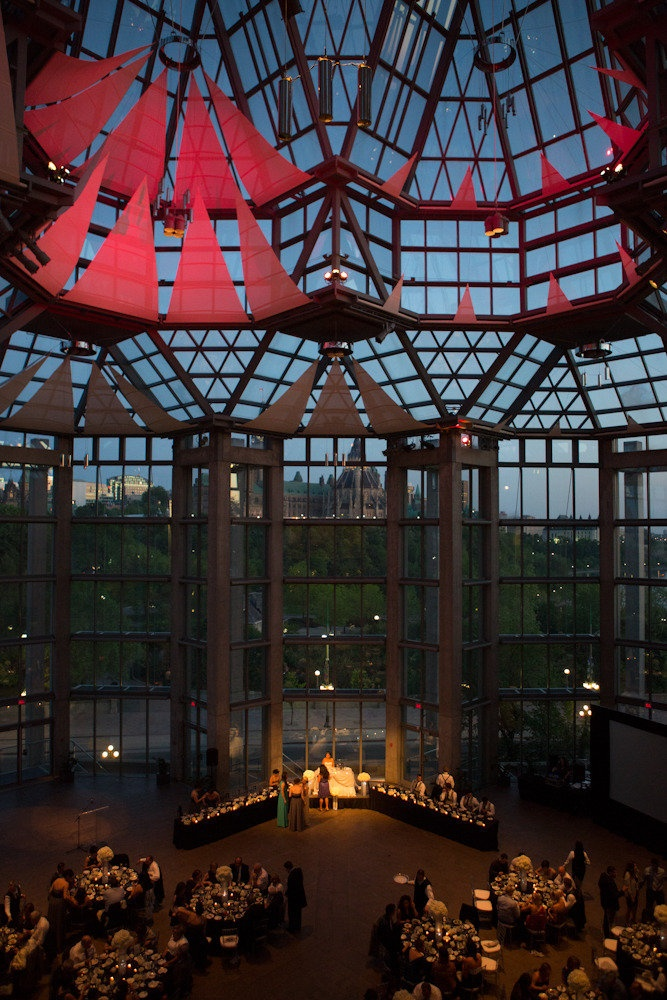 Ottawa's National Art Gallery of Canada makes an amazing and dramatic setting for this wedding reception.  Photos:  James Paul Correia Photography