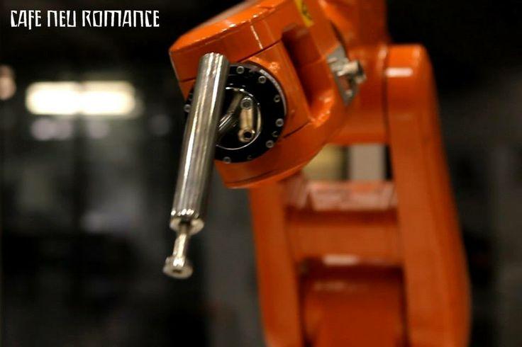 ABB Robotics (SWE): IRB 120.  Info: http://cafe-neu-romance.com/press-media/cnr-2013/cnr-2013-exhibition-abb-robotics-%28swe%29  Video: a) https://vimeo.com/82876163 b) https://vimeo.com/82876999