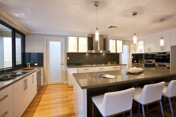 Buck the trend with a dark benchtop and splashback