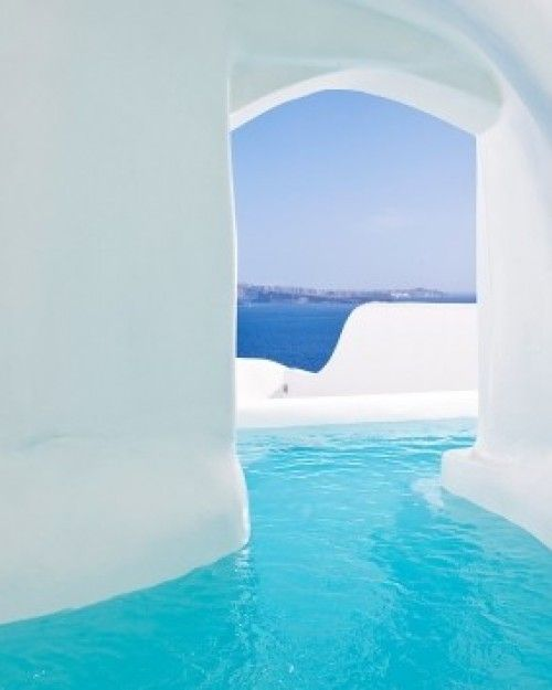 The Canaves Oia Hotel in Santorini, Greece is truly a magical place. With each room having their own outdoor Jacuzzi, this is definitely a spot to stay while traveling on your #honeymoon! #travelingTOMS